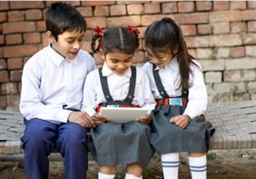 Indian school girl with tablet Fakt Gujarati