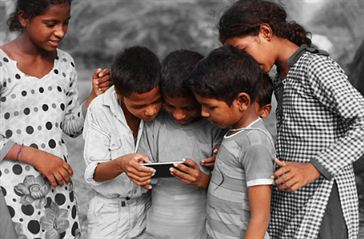 Indian teenagers with mobile Fakt Gujarati