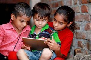 Indian children with tablet FaktGujarati